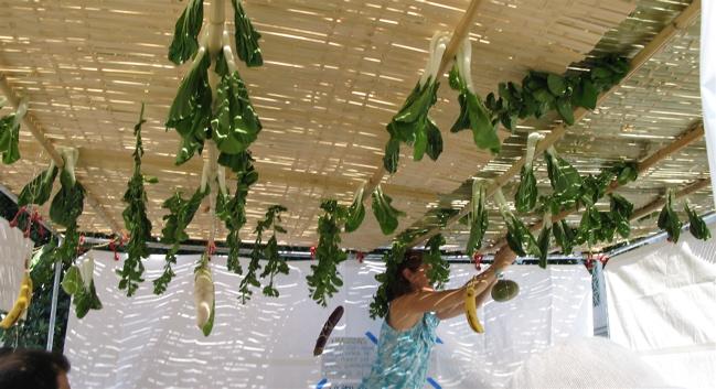 Woman-decorating-sukkah-Sukkot
